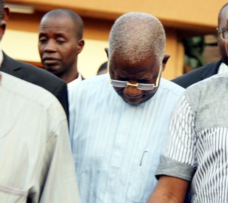 Ex Civil Service Boss Shies Away from Cameras as Court Grants Him Bail (Photos)