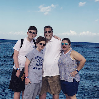 A photo of David Brodosi and his family outdoors traveling to the beach.
