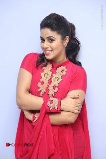 Actress Poorna Latest Stills in Red Dress at Rakshasi First Look Launch  0099.JPG