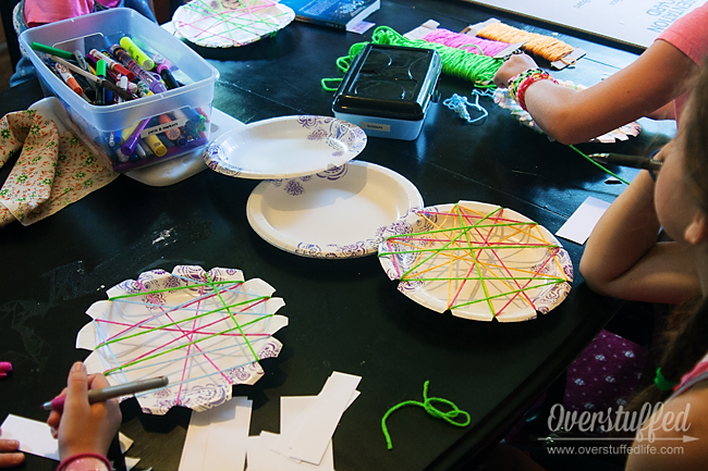 Charlotte's Web Book Club Craft: Paper Plate and Yarn spider webs