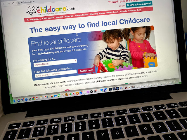 photo of a MacBook open on the childcare.co.uk website home page