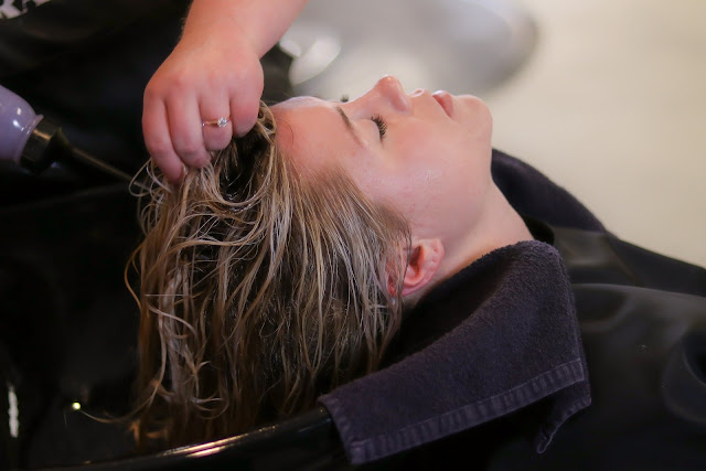 Woman at the Hairdressers having hair washed