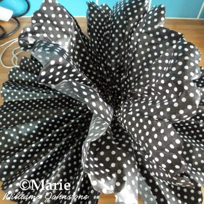 Black polka dot paper for a craft
