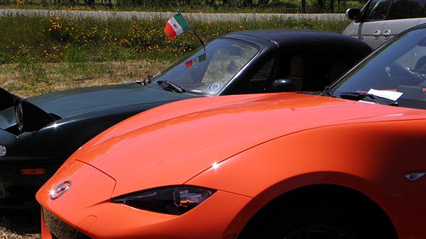 British Racing Green and Orange Miatas