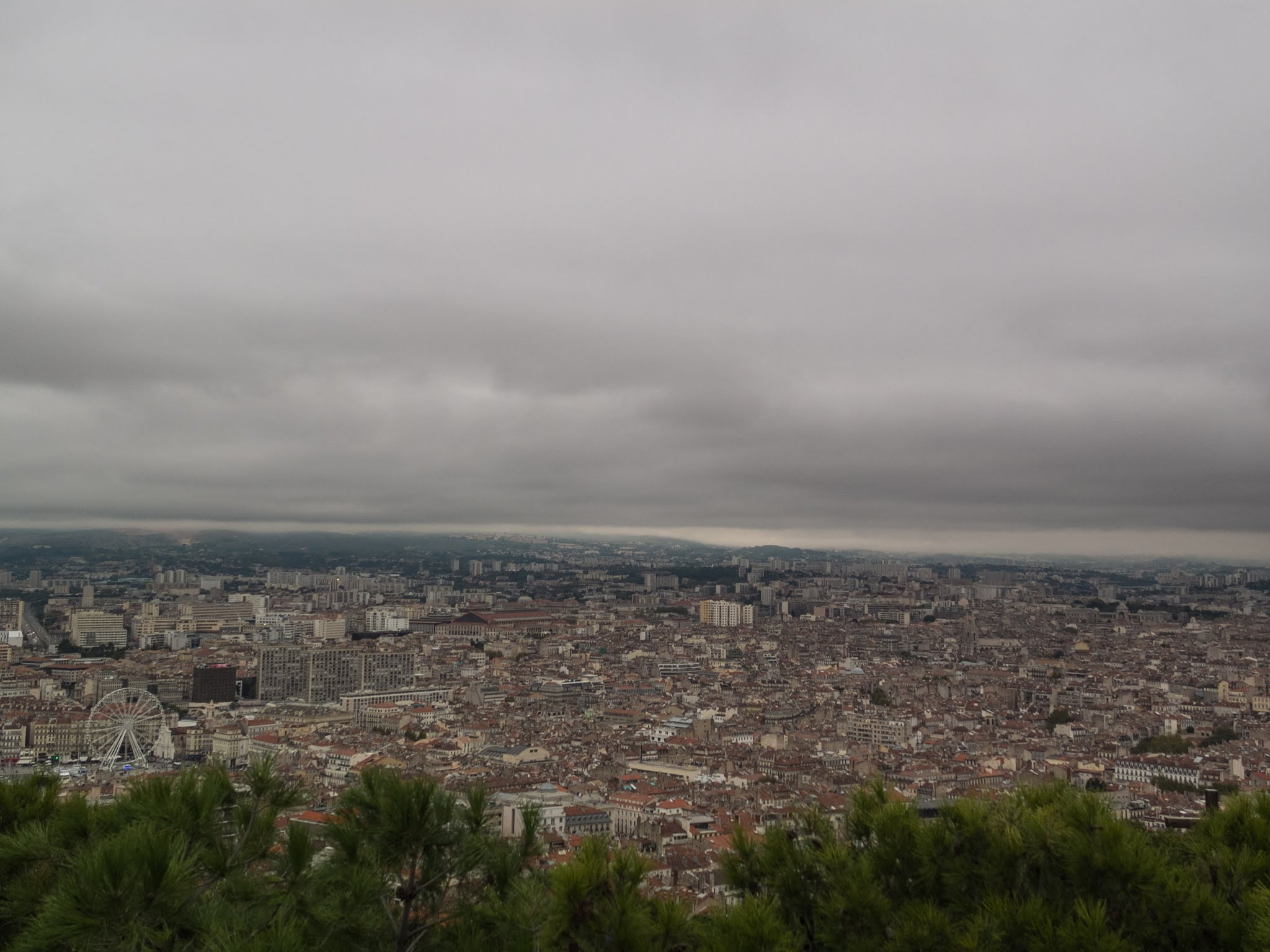 View of Marseille from La Garde on a rainy, overcast day.
