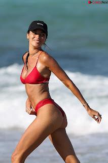 Nicole Williams in Orange Bikini on the beach    Butts ~ Celebrity.co Exclusive Celebrity Pics 001