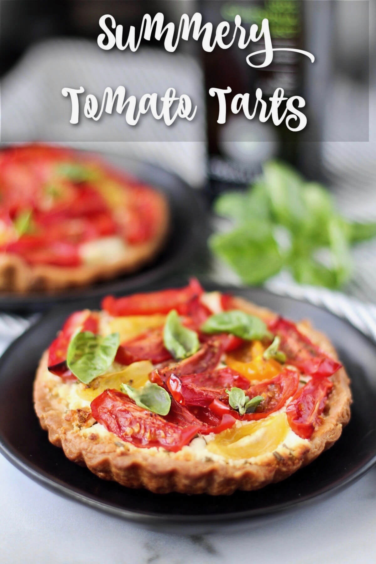 Tomato and Goat Cheese Tarts with Basil on top.
