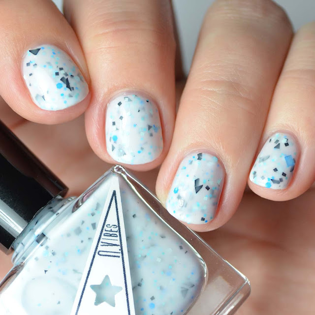 white nail polish with blue and black glitter