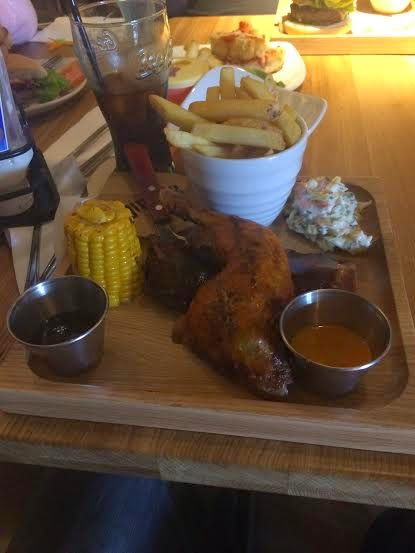 chicken leg, rib, chips, corn on cob, coleslaw and dips