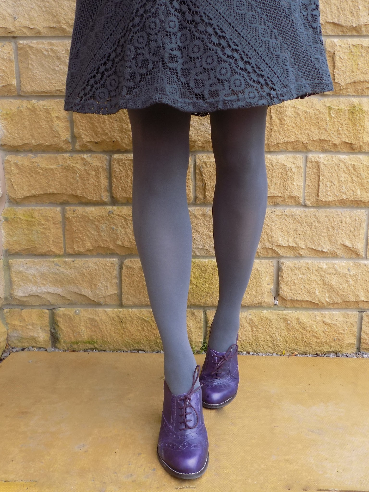 Purple high heeled brogues with grey opaque tights