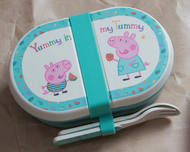 An oval bamboo Peppa Pig large snack box with silicone seal holding a spoon and fork
