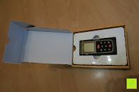 Verpackung öffnen: Laser-Entfernungsmesser, Jetery Digital Laser Distanzmessgerät Messung von Distanz, Flächen, Volumen|+/-2mm Messgenauigkeit|Laser Distanzmesser m/in/ft IP54 Schutz mit LCD Display, Wasserwaage, Batterien, Schutztasche (40M)