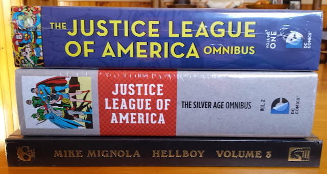Picture showing the Juste League of America Omnibus and Hellboy Volume 3