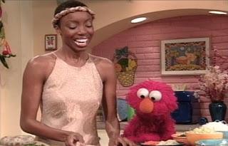 Heather Headley and Elmo. Sesame Street Elmo's Magic Cookbook