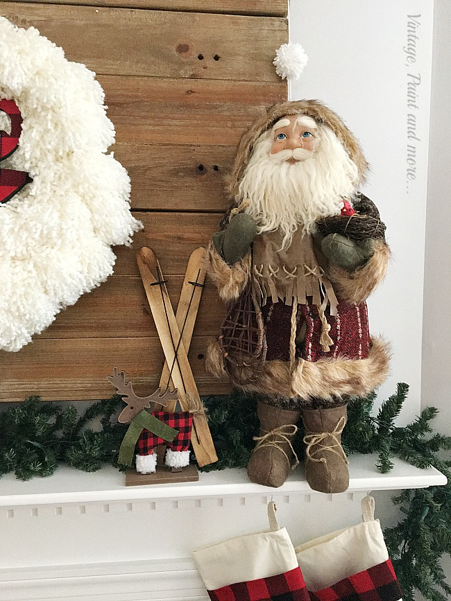 Vintage, Paint and more... an old world Santa and a dollar store buffalo plaid moose help to make a rustic farmhouse Christmas mantel