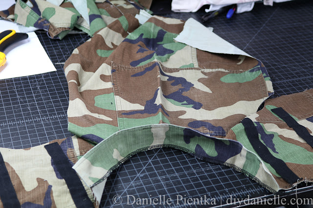 Sew on your collar for the Nerf vest. This one used upcycled camo.