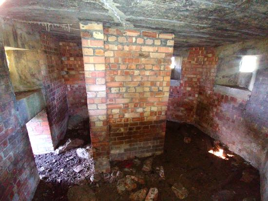 Photograph of The interior of the type 24 pillbox in the fields of Boltons Park Farm  Image by the North Mymms History Project released under Creative Commons BY-NC-SA 4.0