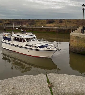 Photo of Ravensdale heading out of the marina gate. Photo by Malcolm Keeler