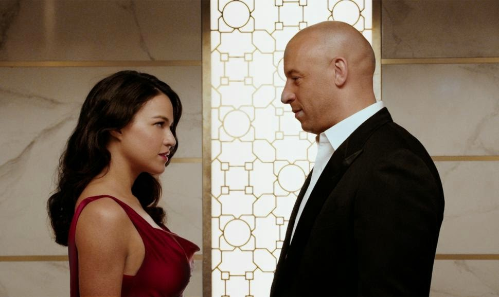 Vin Diesel (right) and Michelle Rodriguez in Fast & Furious 7, Directed by James Wan