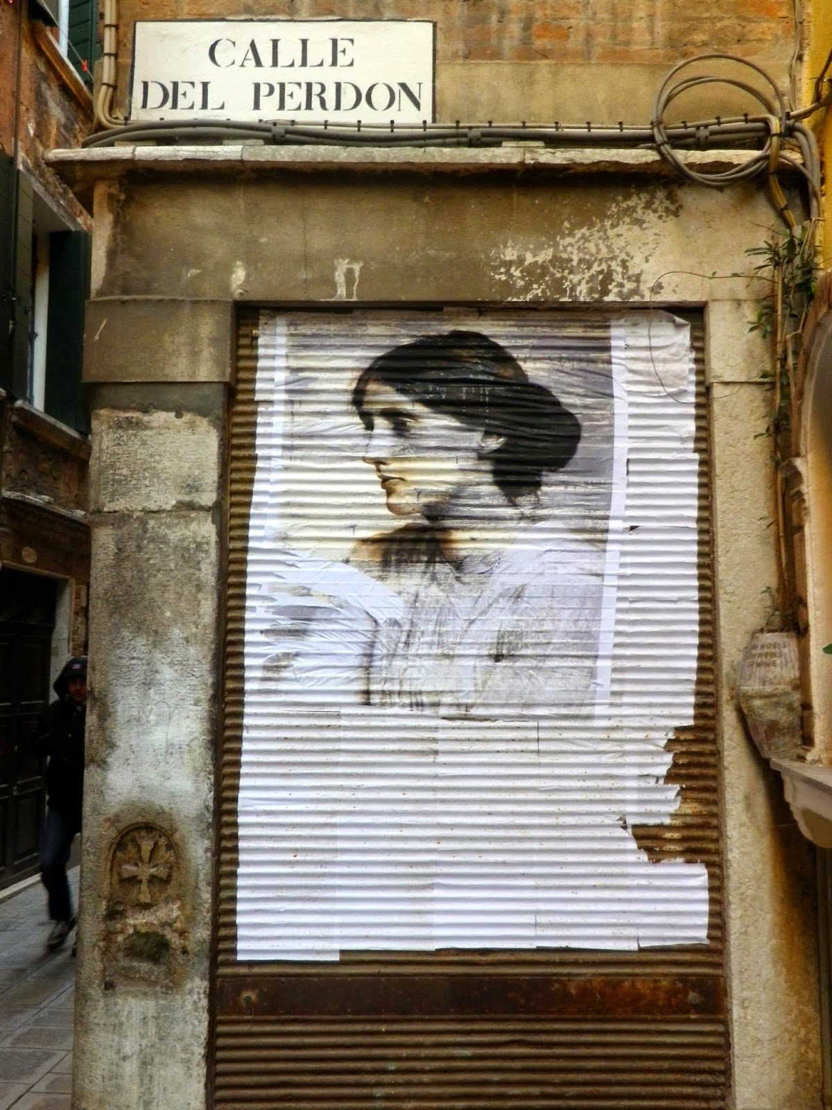 A poster of Virginia Woolf in the Calle del Perdon in Venice.