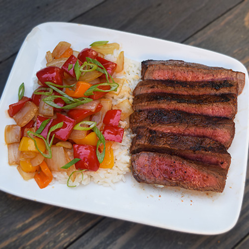 Grilled sirloin steak and sweet and sour stir fry on the Big Green Egg.