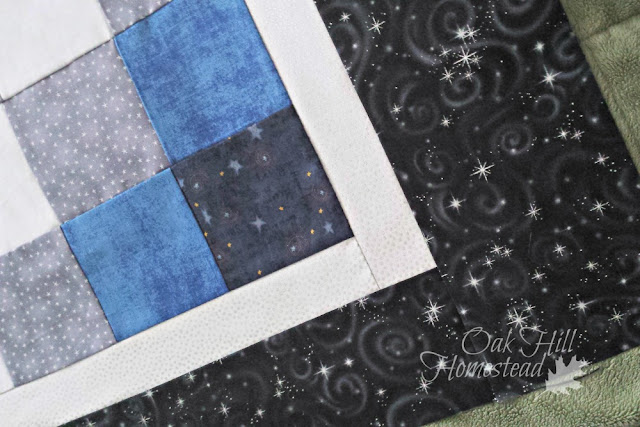 The Starry Night crib quilt is made of fabrics with star prints.