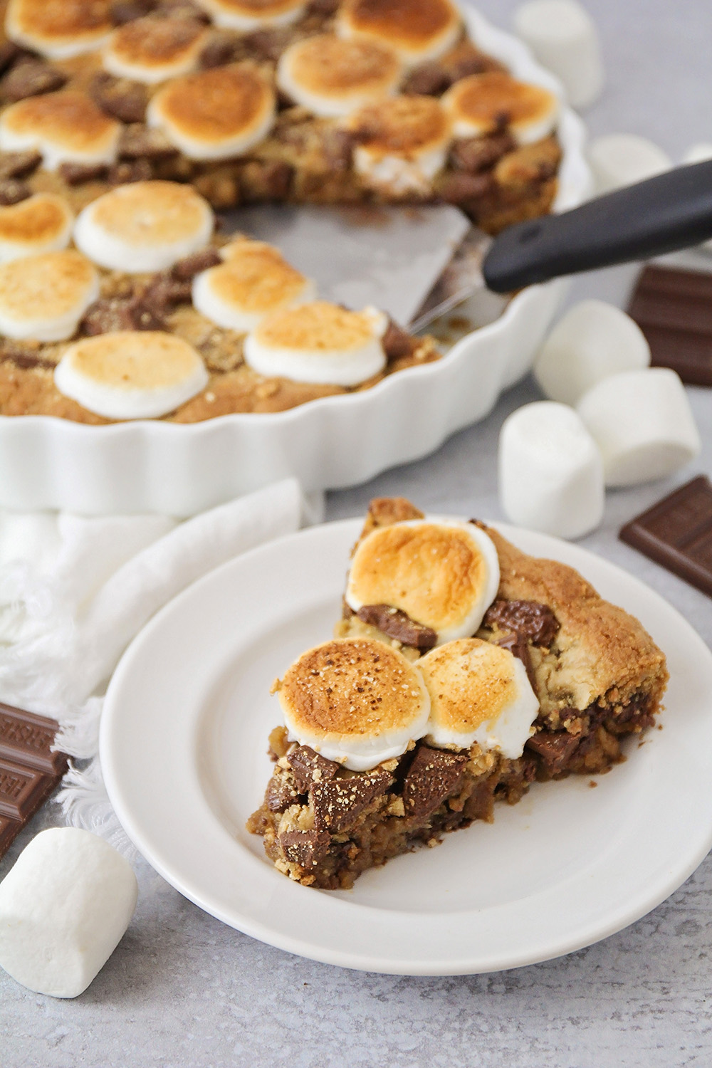 This decadent and delicious s'mores cookie cake is so easy to make!