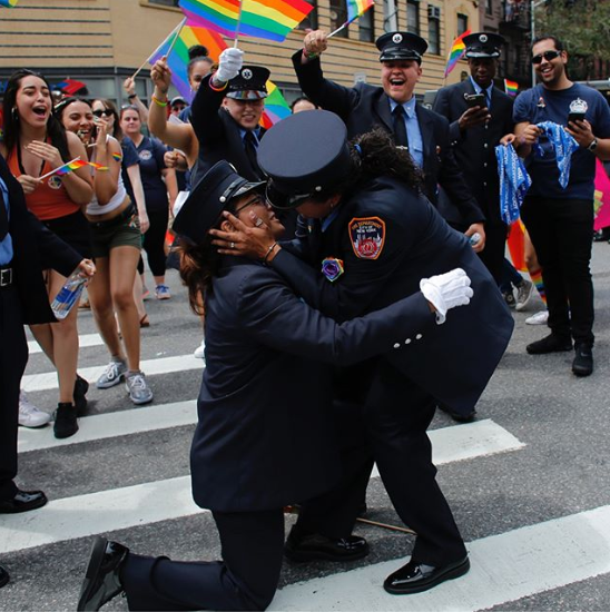 Two fire department medics leave spectators emotional as they get engaged at the Pride parade