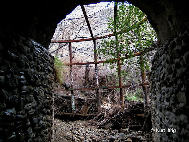 This is the north side of a drainage tunnel built in 1946. The gate was used to catch debris.