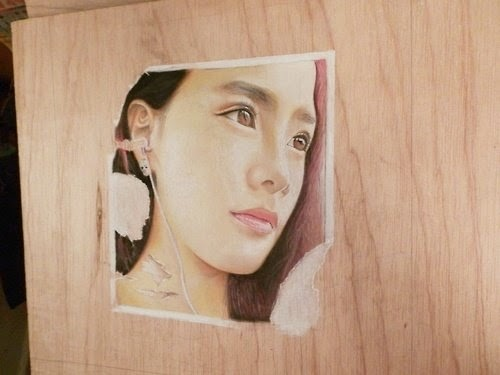 11-Torn-Sticker-Hayley-Hyper-Realistic-drawings-on-Boards-www-designstack-co