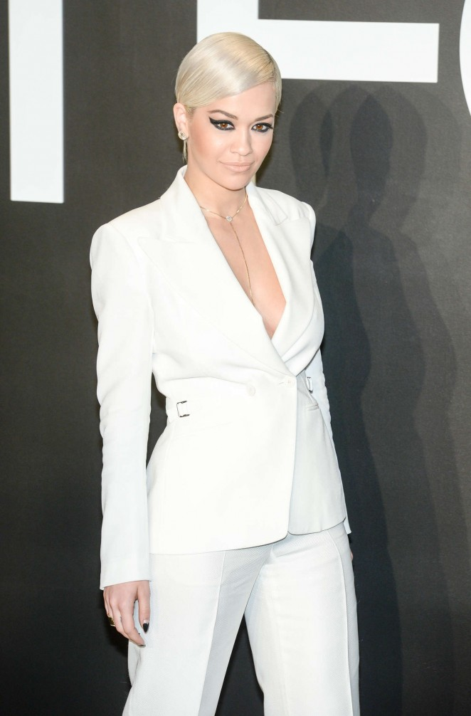Rita Ora wears a low-cut white pant suit to the Tom Ford Fall/Winter 2015 Fashion Show in LA