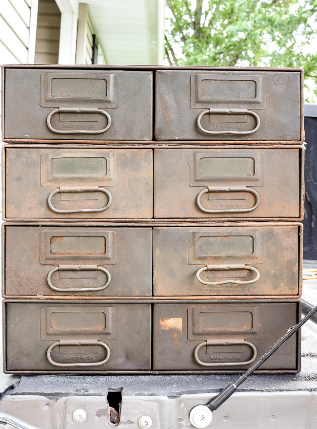 Industrial metal storage drawers before