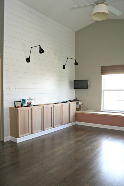 craft room with planked walls