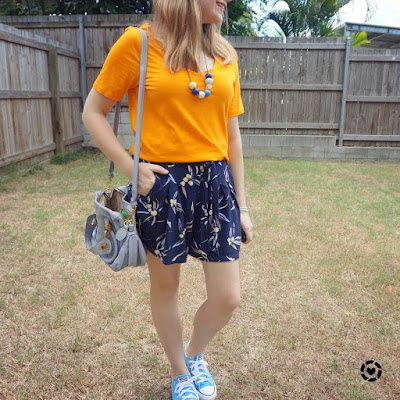 awayfromtheblue Instagram | marigold orange tee with kmart navy printed culottes chloe paraty bag