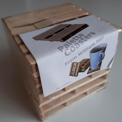 Stack of pallet coasters in packaging.