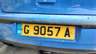 Photo of a yellow vehicle registration plate (license plate) in Gibraltar, showing the pan-European plate design and GBZ country code designation.