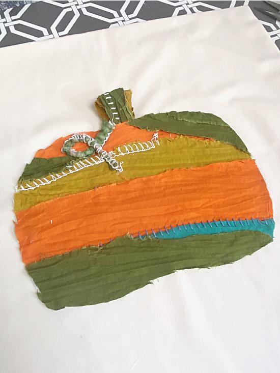 fabric scrap pumpkin on white velvet pillow cover
