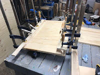 Long edges clamped and glued in place