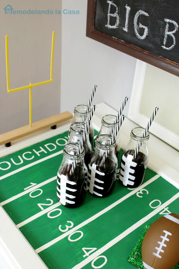 A cabinet door is repurposed into a Football field tray