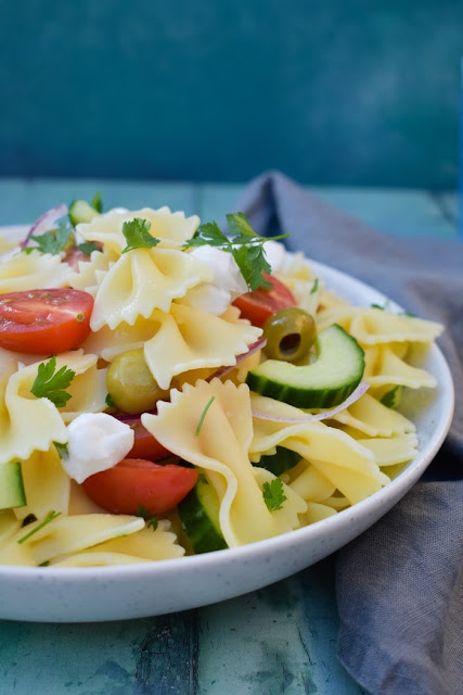 Bowl of Summer Greek Pasta Salad with cucumber and tomato