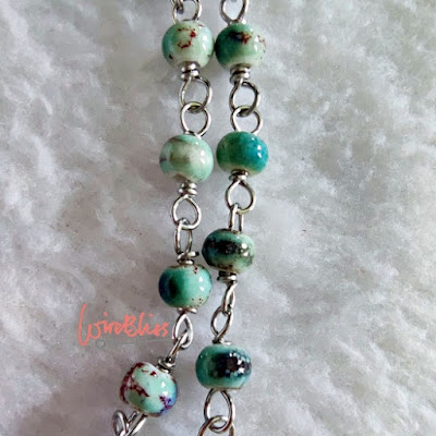 Wire wrapped ceramic beads bracelet close up