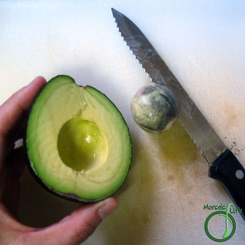 Morsels of Life - How to Cut an Avocado Step 3 - Stick knife into seed, rotating slightly to loosen and remove seed.