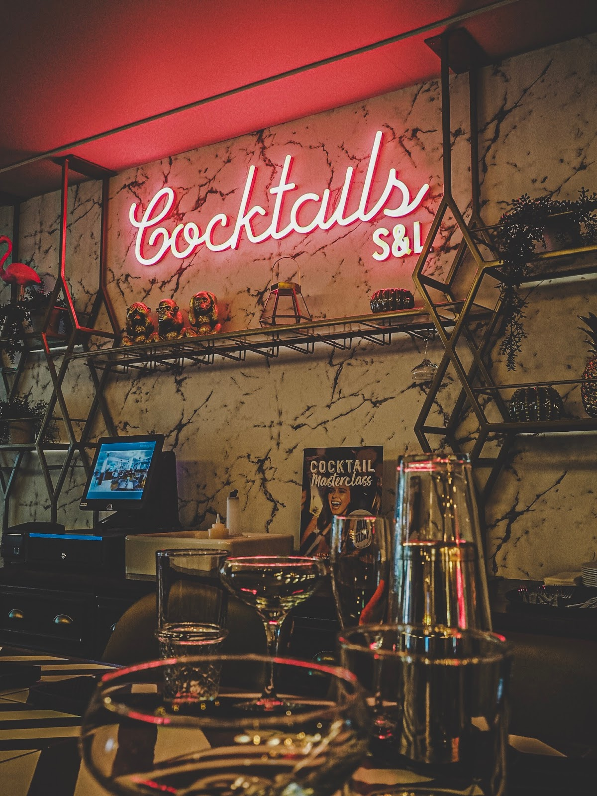 "A pink neon sign reading ""cocktails"""