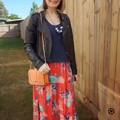 awayfromtheblue Instagram | winter church outfit floral print maxi dress worn as skirt tee layered over top with leather jacket
