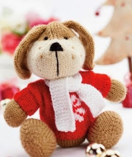 http://www.letsknit.co.uk/free-knitting-patterns/rhubarb-the-huggable-pup