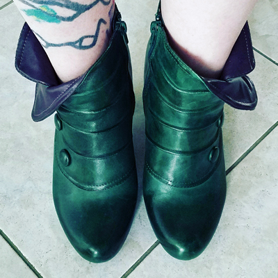 image of green ankle boots with purple trim