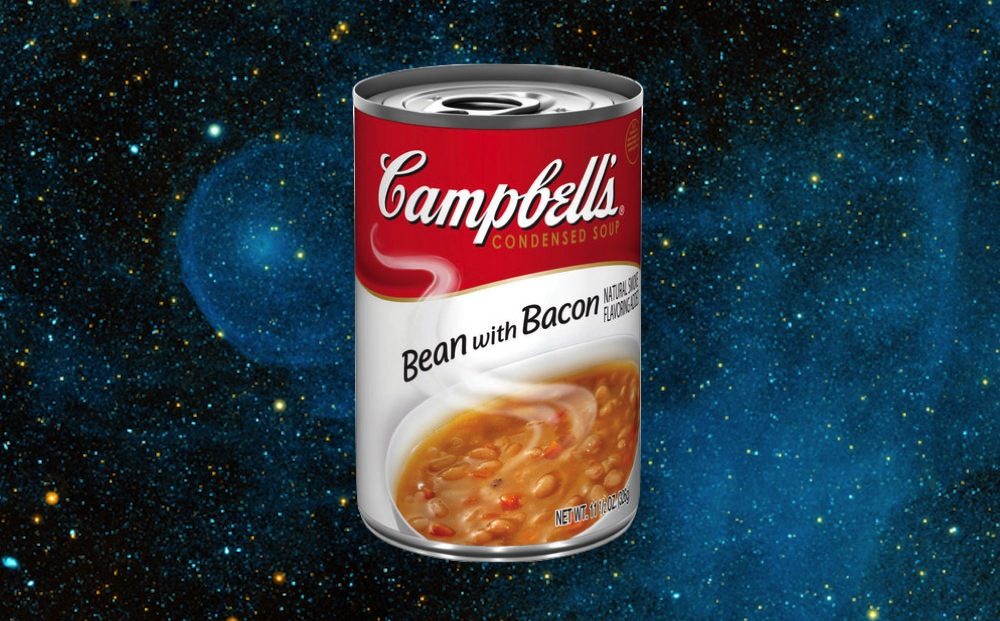 can of Campbell's Bean with Bacon soup against starry void of space