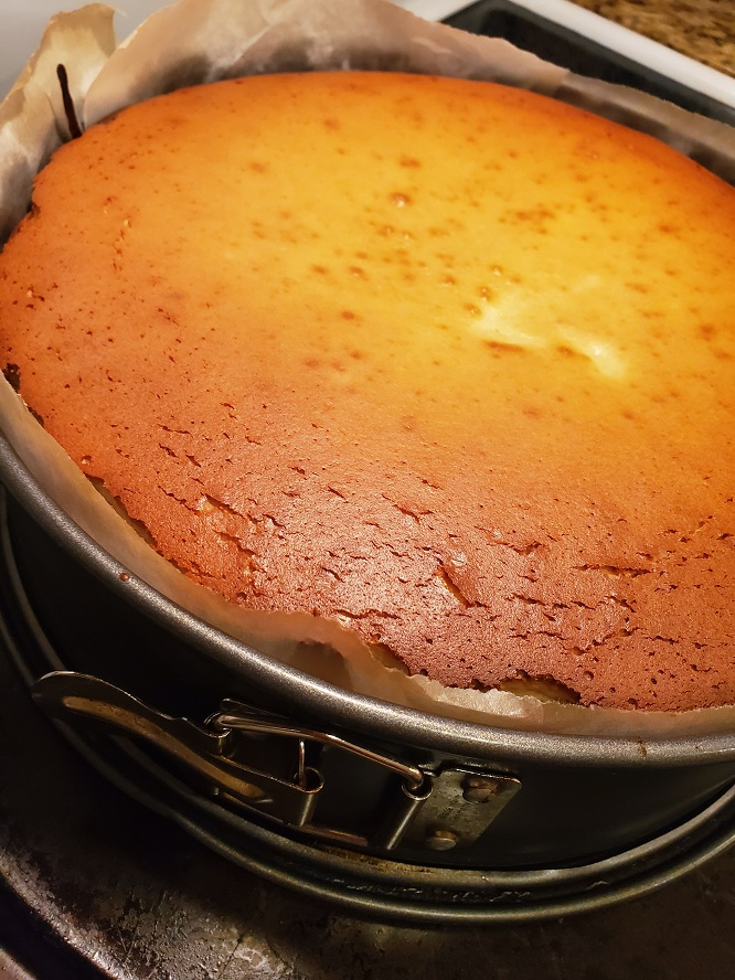 this is a baked new york cheesecake in a springform pan
