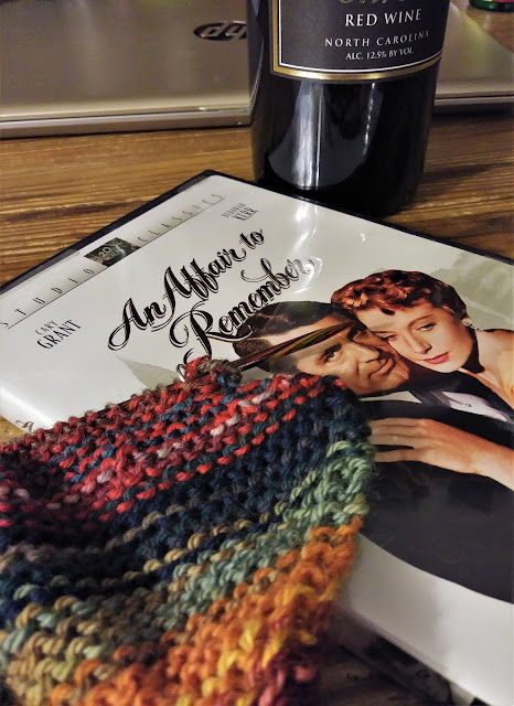knitting a blanket while watching An Affair to Remember and drinking a bottle of wine.