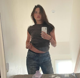 Jules LeBlanc clicking picture of herself
